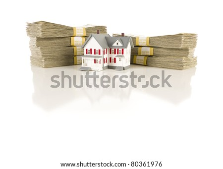 Stacks of One Hundred Dollar Bills with Small House on Slight Reflective Surface. - stock photo
