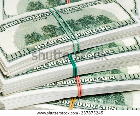 Stacks of one hundred dollars banknotes. - stock photo