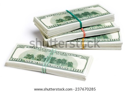 Stacks of one hundred dollars banknotes isolated on white. - stock photo