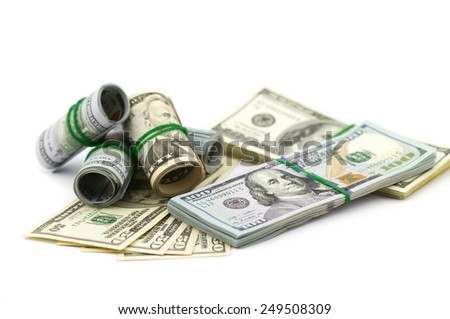Stacks of one hundred dollars isolated on white background - stock photo