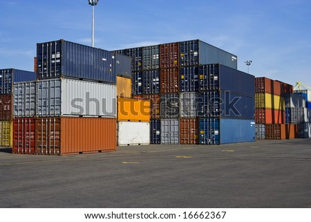 Stacks of orange and blue containers in a major port - stock photo