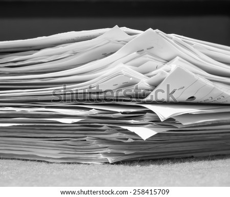 Stacks of paper - black and white - stock photo