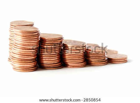 Stacks of pennies against a white background - stock photo