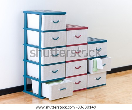 Stacks of plastic drawers for home or office using - stock photo