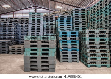 Stacks of plastic pallets in a warehouse