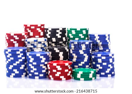 Stacks of poker chips on a white background - stock photo