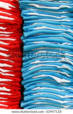 Stacks of red and light blue T-shirts - stock photo