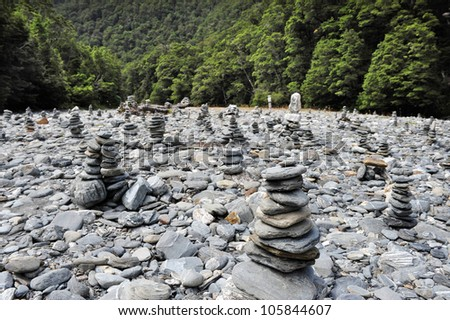 Stacks of rocks at Fantail Falls at the trailhead for Mt. Brewster at the Haast Pass road on New Zealandas South Island.