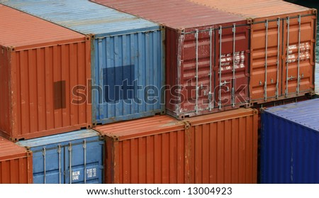 Stacks of shipping contaners at a port. - stock photo