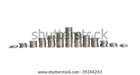 Stacks of silver coins in the form of the diagram, isolated over white background. Shallow DOF. - stock photo