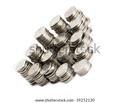 Stacks of silver coins, isolated over white background. Shallow DOF. - stock photo