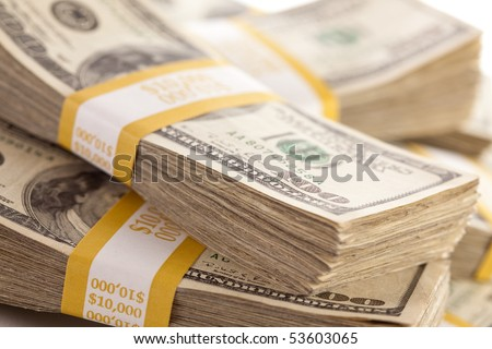 Stacks of Ten Thousand Dollar Piles of One Hundred Dollar Bills. - stock photo