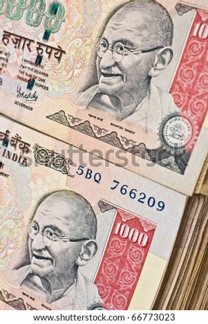 Stacks of thousand rupee notes (Indian currency). - stock photo