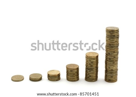 Stacks of used, dirty Australian 2 dollar coins showing exponential growth, isolated over white.  Concept of profit, financial growth - stock photo