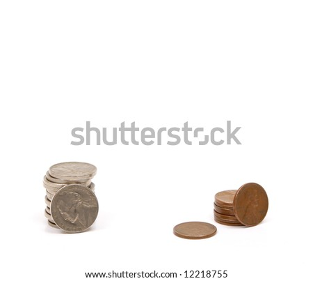 Stacks of vintage American coins of various denominations. Old coins are becoming increasingly valuable due to their high content of silver and copper. - stock photo