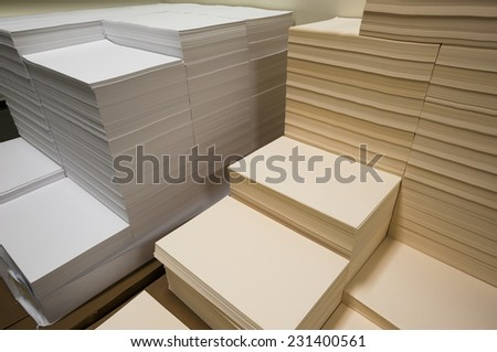 Stacks of white and beige paper - stock photo