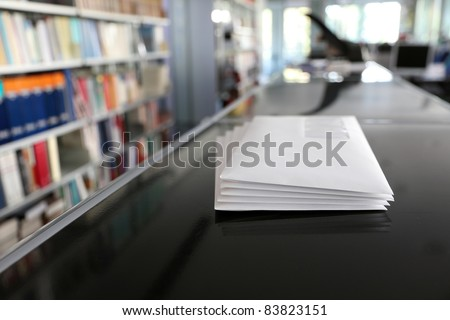 Stacks of white mail envelopes in office - stock photo