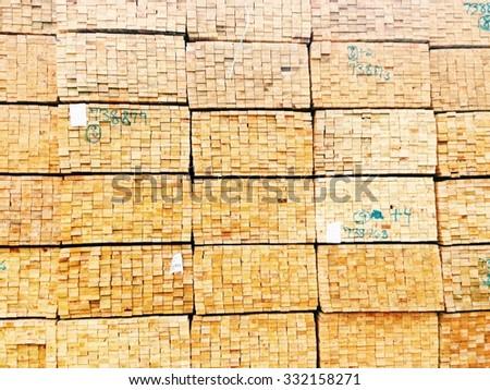 Stacks of 2x4's at a lumber yard - stock photo