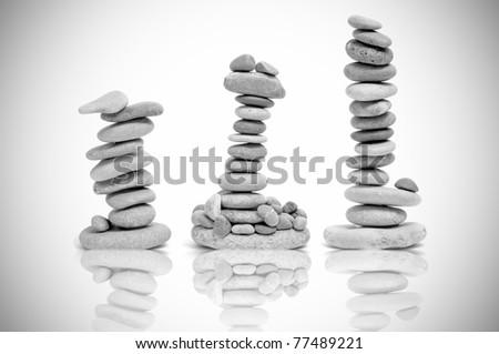stacks of zen stones in black and white - stock photo