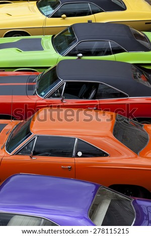 Stade, Germany - May 2, 2015: High angle view of vintage Plymouth Roadrunner and Dodge Charger cars exhibited at MOPAR Spring Fling annual meeting for vintage cars built by Chrysler Corp. - stock photo