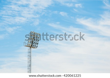 Stadium floodlight tower with blue sky background