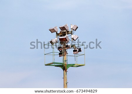 Stadium floodlight tower with reflectors with blue sky. Lighting pole tower at the sports stadium & Loudspeaker Pole Blue Sky Stock Photo 204607024 - Shutterstock azcodes.com