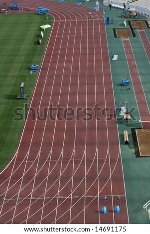 stadium hundred meters sports track lanes and long jump detail from athens greece olympic stadium - stock photo