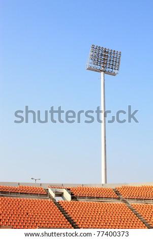 Stadium light against blue sky - stock photo