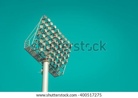 Stadium light against blue sky , vintage tone - stock photo
