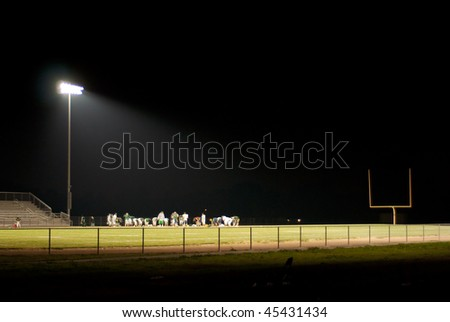 stadium light shines brightly on the field - stock photo
