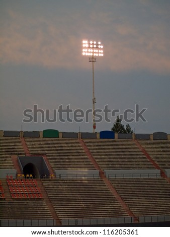 Stadium Lights Against an Evening Sky at Dusk - stock photo