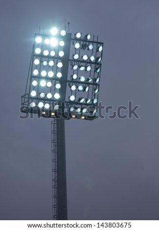 Stadium Lights against Dark Night - stock photo