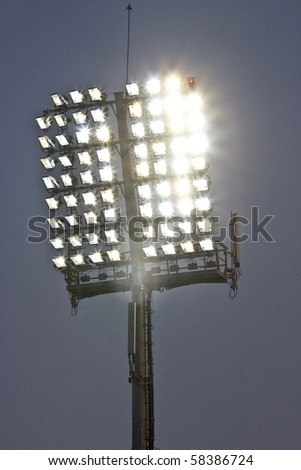 Stadium lights and dark blue sky - stock photo