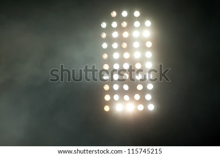 stadium lights at night with smoke - stock photo