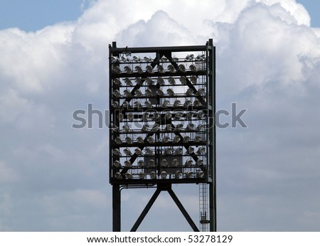Stadium lights hung and suspended on a large metal structure, during the daytime so the lights are off.  located at ATT Park San Francisco California. - stock photo