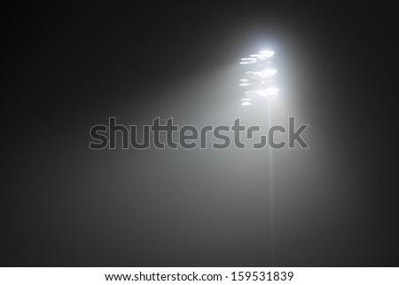Stadium Lights in fog no.2 - stock photo