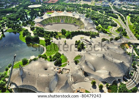 "Stadium of the Olympiapark in Munich, Germany, is an Olympic Park which was constructed for the 1972 Summer Olympics. Found in the area of Munich known as the ""Oberwiesenfeld"" (""upper meadow-field""),"