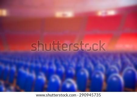 stadium seats blurred background - stock photo