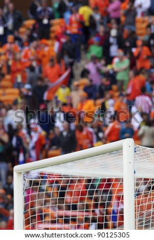 Stadium soccer goal with background spectators. - stock photo