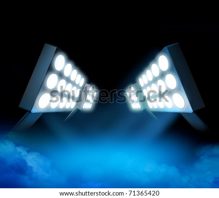 Stadium style lights illuminating blue surface premiere with color smoke - stock photo