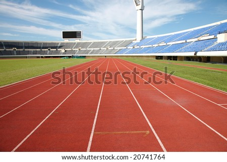 stadium track and field area empty on a sunny day - stock photo