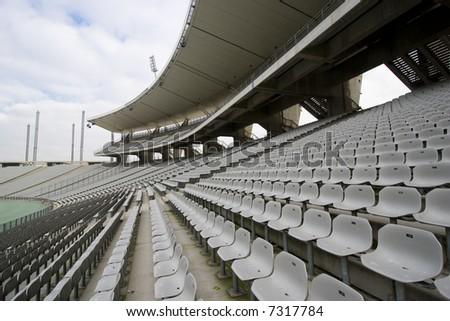 Stadium with empty seats - stock photo