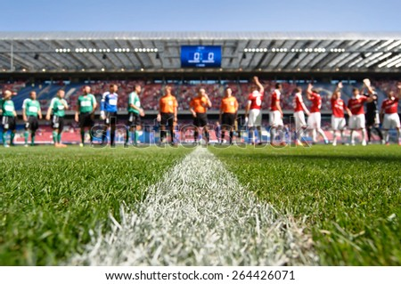 stadium with players before the match - stock photo