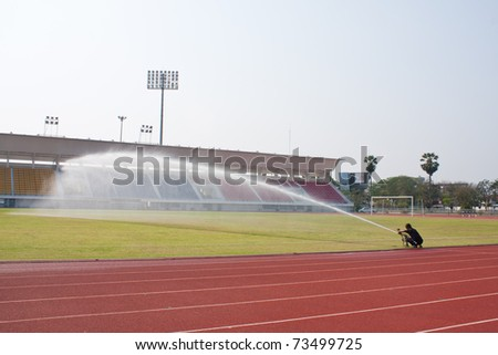 Staff are watering lawns. So ready for the competition. - stock photo