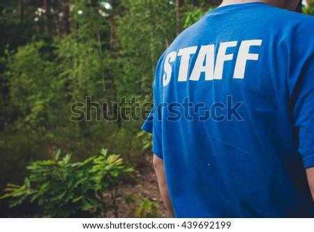 Staff .  inscription on Clothing - stock photo