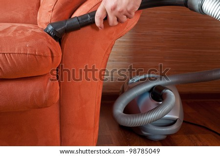 Staff produces upholstered furniture cleaning - stock photo
