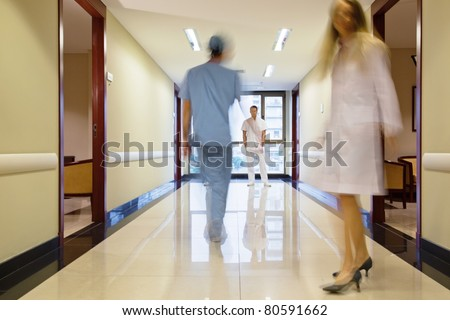 Staff walking through the hallway in hospital
