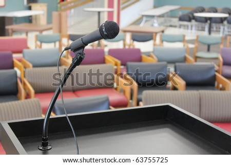 Stage in front of empty chairs - stock photo