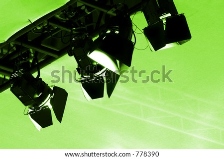 Stage lights, green toned - stock photo
