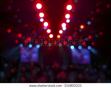 Stage lights in a concert of different colors. Blurred colorful background